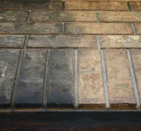 clean soot from brick